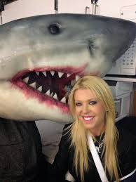 """""""Yeah, just keep smiling, Tara.  And don't move!  Hold this bucket of chum!"""""""