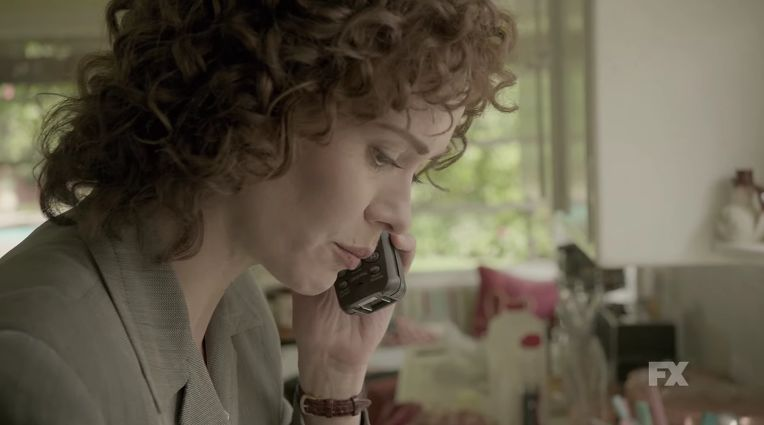 """The cordless phone says """"90s Chic"""", and the perm says """"Of course this isn't my first divorce!"""""""
